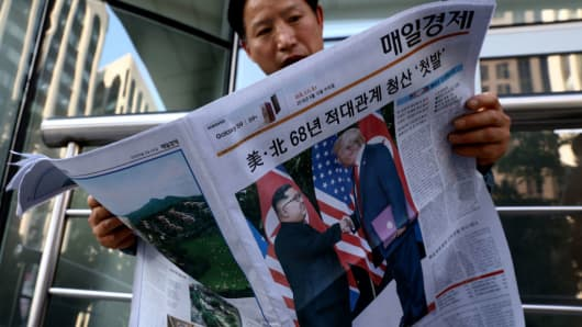 A South Korean man reads a newspaper reporting the U.S. President Trump meeting with North Korean leader Kim Jong-un on June 12, 2018 in Seoul, South Korea.