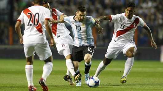 Lionel Messi of Argentina drives the ball during a match between Argentina and Peru.