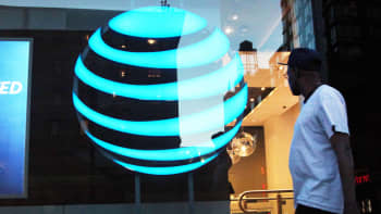 A pedestrian walks in front of an AT&T location in New York.