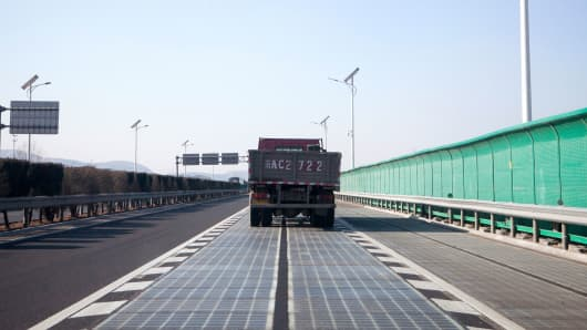 A truck drives on the solar road in Jinan, China.