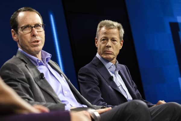 Randall Stephenson, chairman and chief executive officer of AT&T Inc., left, speaks while Jeffrey 'Jeff' Bewkes, chairman and chief executive officer of Time Warner Inc.