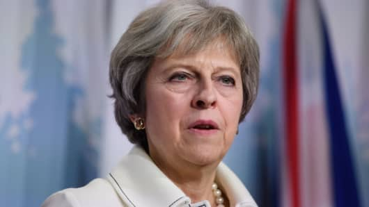 Britain's Prime Minister Theresa May holds a press conference at the end of the second day of the G7 Summit on June 9, 2018 in La Malbaie, Canada.
