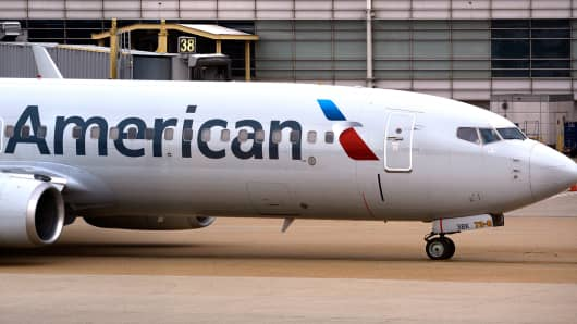 An American Airlines Boeing 737 passenger plane taxis from a gate to the runway at Ronald Reagan Washington National Airport in Washington, D.C.