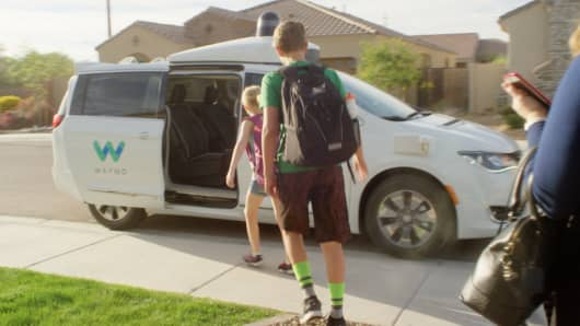 Early rider use the Waymo driverless vehicles to get to school.