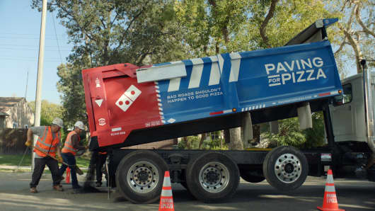 Domino's is giving grants to local communities to fill potholes.