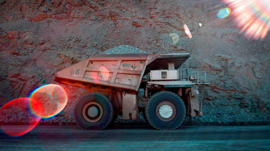An industrial dump truck transports a load of rocks at the Asarco LLC Ray Operations copper mine in Kearny, Arizona.