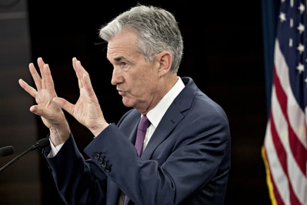 Here's how the markets are reacting to Fed Chair Powell's presser following rate hike