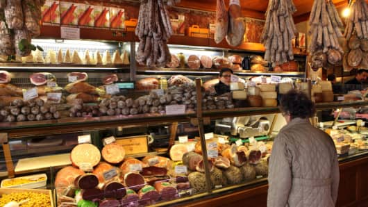 A shopper stands at the meat counter at the renowned Tamburini salsamenteria on March 29, 2017 in Bologna, Italy.