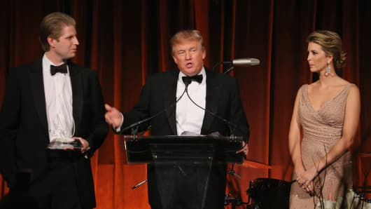 Eric Trump, Donald Trump and Ivanka Trump speak during a charity event in New York City in 2012.