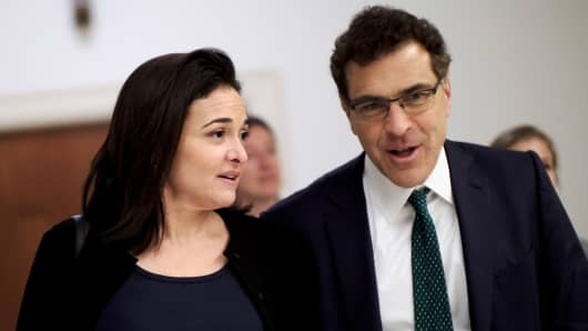 Facebook Chief Operating Officer Sheryl Sandberg and Vice President of global communications and public policy Elliot Schrage on Capitol Hill after meeting with U.S. Rep. Jackie Speier (D-CA) in Washington, U.S. October 12, 2017.