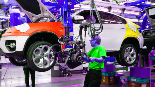 A BMW X6 moves through the assembly line inside the Bayerische Motoren Werke (BMW) factory in Greer, South Carolina.