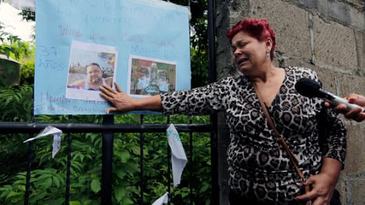 A woman cries while demanding information about her imprisoned son, who was arrested for taking part in protests against President Ortega's government, outside 'El Chipote' prison in Managua on June 13, 2018.