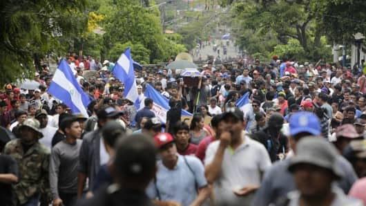 Friends and relatives of Jorge Carrion, 33, shot dead during protests against the government of President Daniel Ortega, carry his coffin during the funeral in the city of Masaya, 35 km from Managua on June 7, 2018.