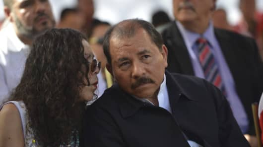 Nicaragua´s President Daniel Ortega and wife Rosario Murillo during meeting to support Hugo Chavez at Miraflores Presidential Palace on January 10, 2013 in Caracas, Venezuela.