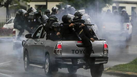 Riot police clash with protesting engineering students in Managua on May 28, 2018.