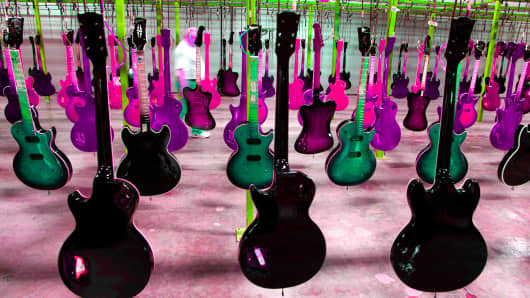 Painted guitars hang to dry after being lacquered at the Gibson Guitar Corp. factory in Nashville, Tennessee.
