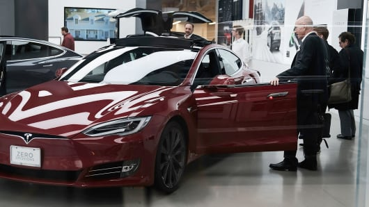 Tesla cars are displayed at a showroom in New York City.