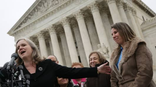 Peggy Young (R), the plaintiff in Young vs UPS, and her attorney Sharon Fast Gustafson (L), answer questions outside the U.S. Supreme Court after the court heard arguments in her case December 3, 2014 in Washington, DC.