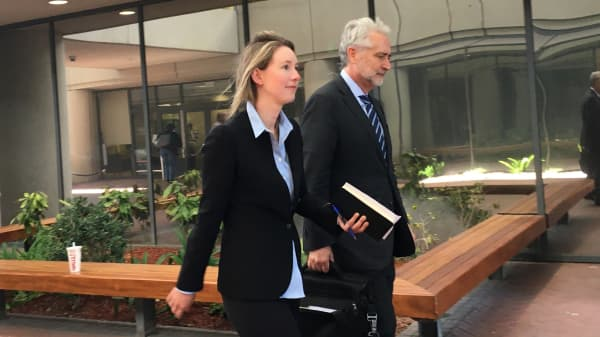 Elizabeth Holmes, former CEO of Theranos leaves the Robert F. Peckham courthouse with her attorney after her arraignment in San Jose on June 14th, 2018.