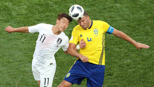 South Korea's Hwang Hee-chan in action with Sweden's Andreas Granqvist at the 2018 World Cup in Nizhny Novgorod, Russia.