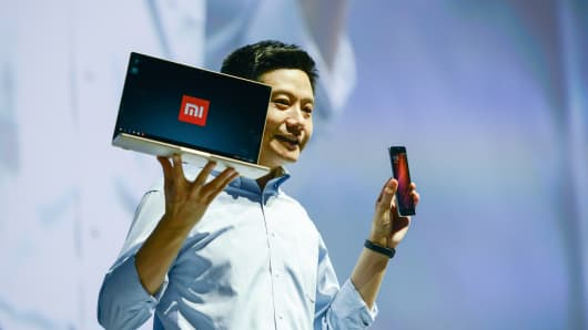 Xiaomi's CEO Lei Jun introduces Mi Notebook Air and Redmi Pro phone on a new products launch event.