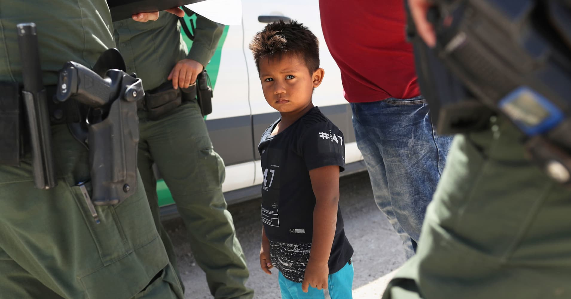 U.S. Border Patrol agents take into custody a father and son from Honduras near the U.S.-Mexico border on June 12, 2018 near Mission, Texas.