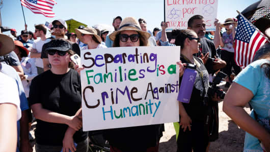 People participate in a protest against a recent U.S. immigration policy of separating children from their families when they enter the United States as undocumented immigrants, outside the Tornillo Tranit Centre, in Tornillo, Texas, June 17, 2018.