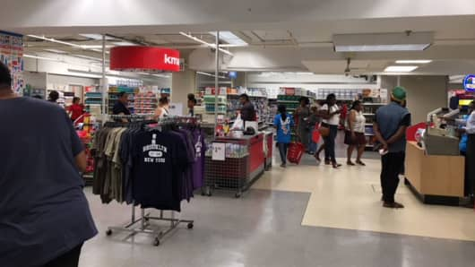 The Kmart shop is located on the lower level of a Sears store in Brooklyn.