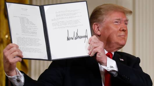 President Donald Trump displays his signature after signing a national space policy directive during a meeting of the National Space Council in the East Room of the White House in Washington, U.S., June 18, 2018.