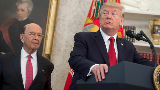 President Donald Trump speaks alongside Secretary of Commerce Wilbur Ross.