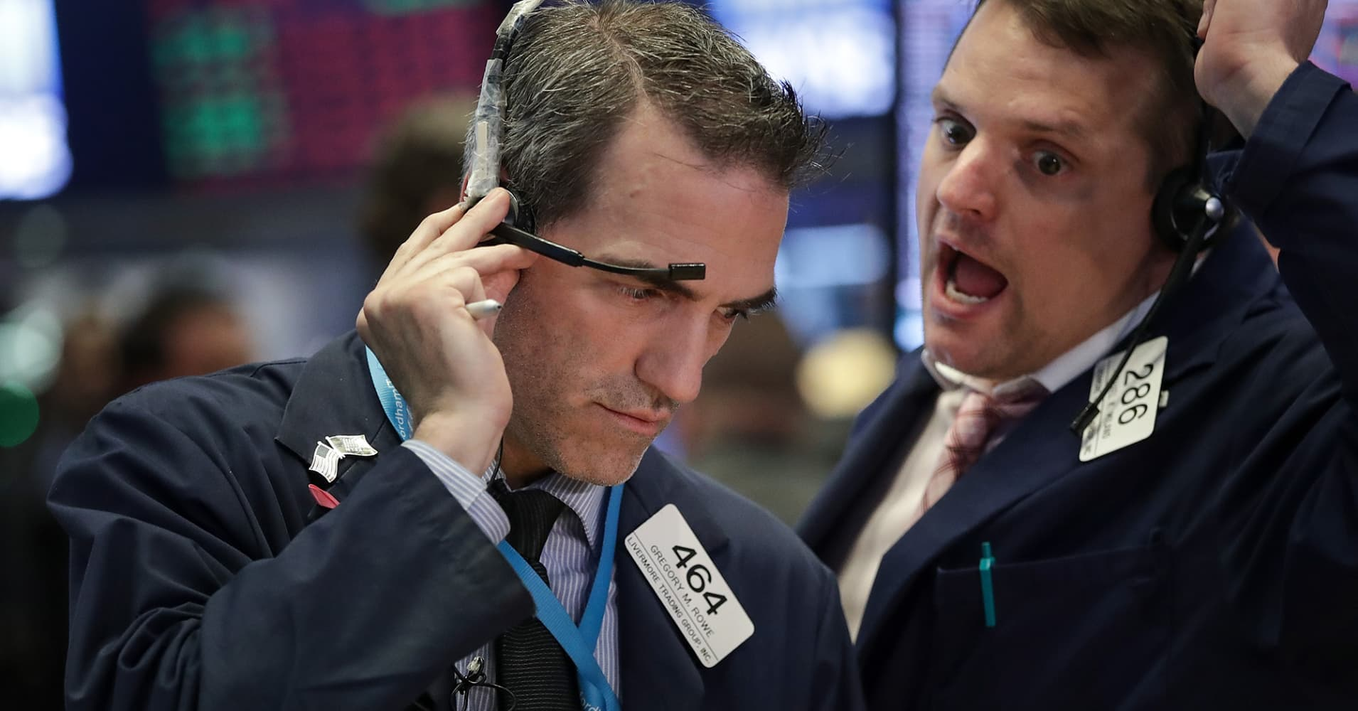 Stocks cling to gains for the year into a second half that could get much worse