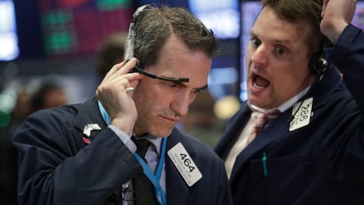 Traders work the floor at the NYSE.