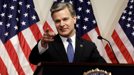 FBI Director Christopher Wray discusseses the findings of the Inspector General's report on the FBI's handling of a probe into former presidential candidate Hillary Clinton, during a news conference in Washington, U.S., June 14, 2018.