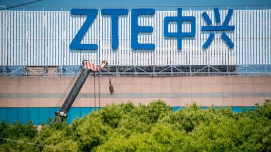 A logo of Chinese telecommunications company ZTE is seen on an office building in Shanghai, China, on May 3, 2018.