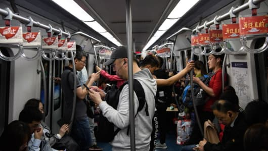 Passenger on a train in the Beijing Subway.
