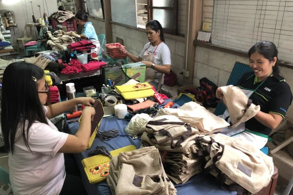 Filipino artisans work at Rags2Riches' factory in Quezon City, The Philippines