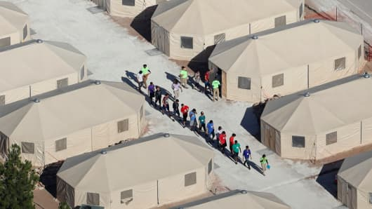"Migrant children, many of whom have been separated from their parents under the ""zero tolerance"" policy by the Trump administration, are being housed in tents next to the Mexican border in Tornillo, Texas, U.S. June 18, 2018."