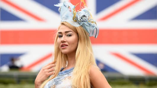 Model Angelina Kali poses in front of a Union Flag display on day 1 of Royal Ascot at Ascot Racecourse on June 19, 2018 in Ascot, England.