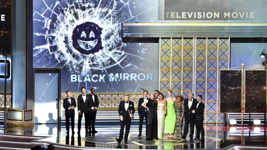 """The cast and crew of """"Black Mirror"""" accept an award onstage during the 69th Annual Primetime Emmy Awards at Microsoft Theater on September 17, 2017 in Los Angeles, California."""