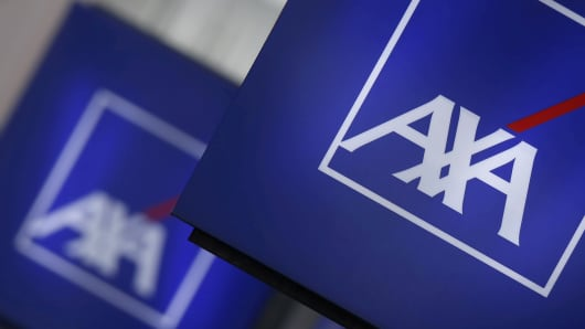 Logos of France's biggest insurer Axa are seen on a building in Nanterre, Paris.