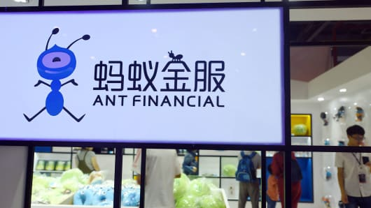People visit a showroom of Ant Financial in Hangzhou, China on June 8, 2018.
