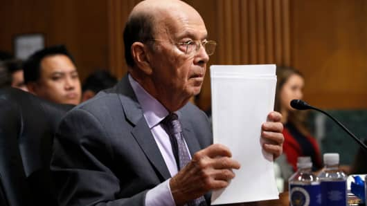 Secretary of Commerce Wilbur Ross straightens his papers during a Senate Finance Committee hearing on tariffs, on Capitol Hill, Wednesday, June 20, 2018 in Washington.
