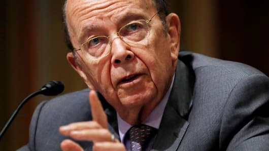 Commerce Secretary Wilbur Ross testifies before a Senate Finance hearing