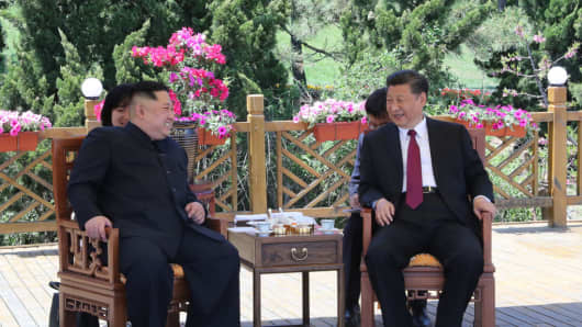 Chinese President Xi Jinping with North Korean Chairman Kim Jong Un in Dalian, China on May 8, 2018.