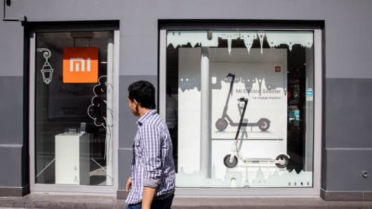 A pedestrian passes outside a Xiaomi Corp. store.