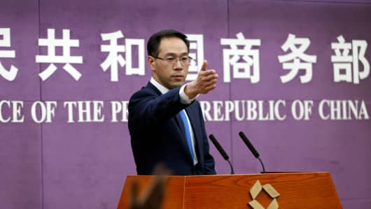 Gao Feng, spokesperson with China's Ministry of Commerce, speaks at a press conference on April 6, 2018 in Beijing, China.