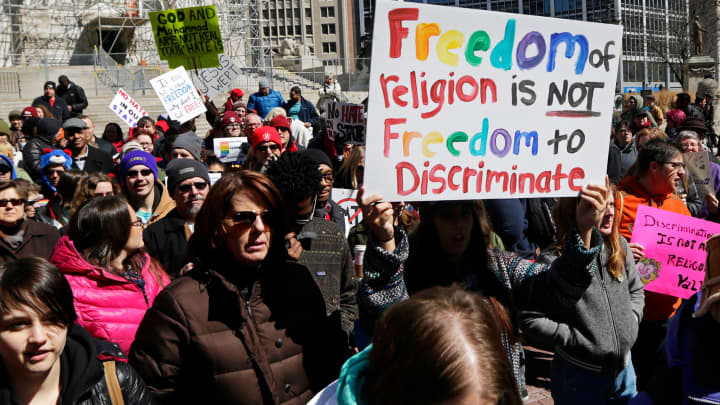 Demonstrators gather at Monument Circle to protest a controversial religious freedom bill during a rally in Indianapolis.