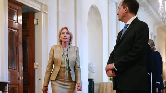 Education Secretary Betsy DeVos (C) and Labor Secretary Alexander Acosta (L) arrive for the National Teacher of the Year award ceremony at the White House May 2, 2018 in Washington, DC.
