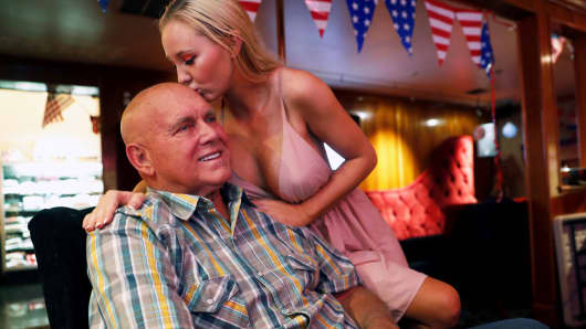 Dennis Hof, a legal brothel owner and recent winner of the Republican primary election for Nevada State Assembly District 36, gets a kiss from Misty Matrix, his girlfriend and a legal prostitute, at his Moonlite BunnyRanch legal brothel in Mound House, Nevada, June 16, 2018.