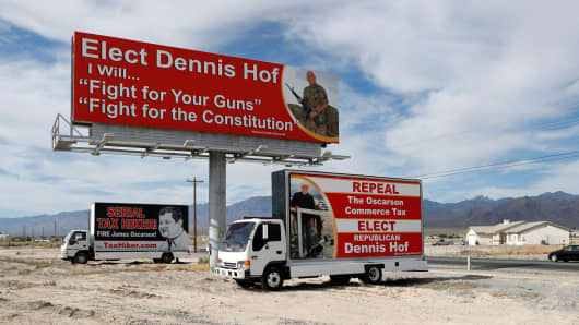 Campaign signs for Dennis Hof are shown along a road in Pahrump, Nevada, June 15, 2018.